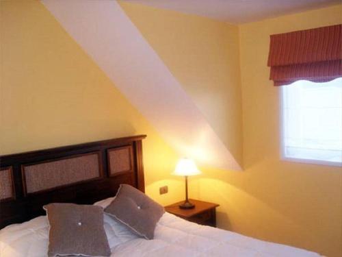 Cama o camas de una habitación en Apart Hotel Croacia