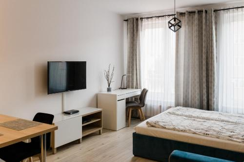 A bed or beds in a room at The Best Stay Central Apartment Gdansk