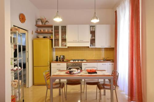A kitchen or kitchenette at San Giovanni Sweet Apartment