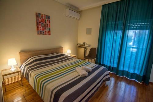 Ένα ή περισσότερα κρεβάτια σε δωμάτιο στο Eftichia's House