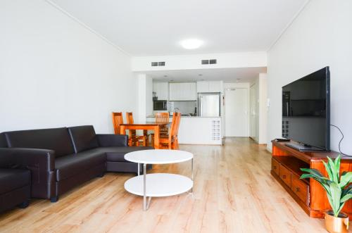 A seating area at RH33 Rhodes 2 bedroom apartment close to Train line