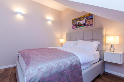Un ou plusieurs lits dans un hébergement de l'établissement Villa Flores