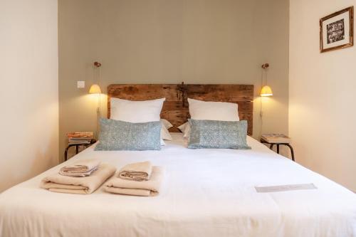 Un ou plusieurs lits dans un hébergement de l'établissement Gris Piedra Home