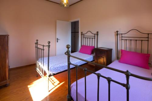 A bed or beds in a room at Hacienda Olivo