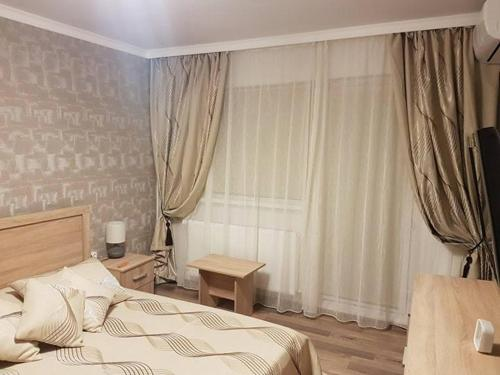 Un pat sau paturi într-o cameră la Casa Mirage 2