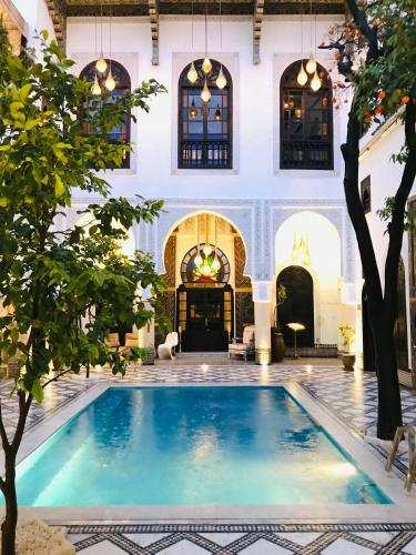 The swimming pool at or near Riad Maison Bleue and Spa