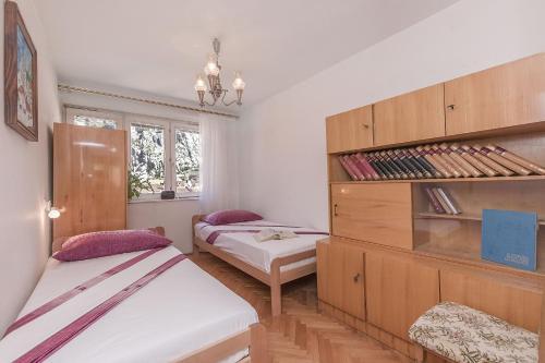 Postelja oz. postelje v sobi nastanitve Apartment Nansy