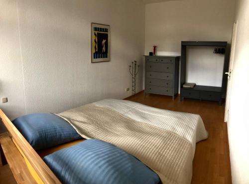 Ein Bett oder Betten in einem Zimmer der Unterkunft Kaßberg-Apartment am Puls der Stadt