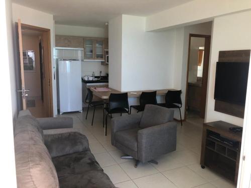 A seating area at Condomínio Riviera - Ponta Negra