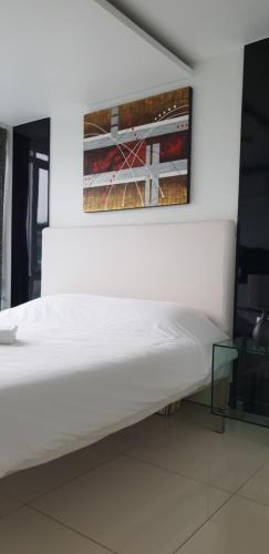 Кровать или кровати в номере City Center Residence Pattaya