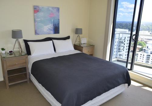 A bed or beds in a room at ACLiving Serviced Apartments