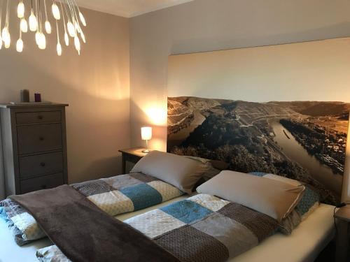 Ein Bett oder Betten in einem Zimmer der Unterkunft Ferienwohnung Laurent