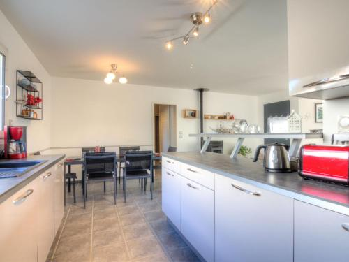 A kitchen or kitchenette at Holiday Home La Plage
