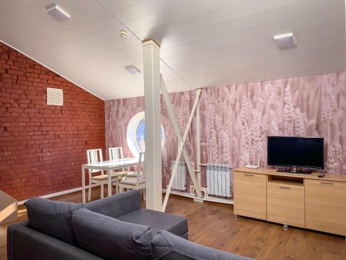 Телевизор и/или развлекательный центр в Apartments Vyborg