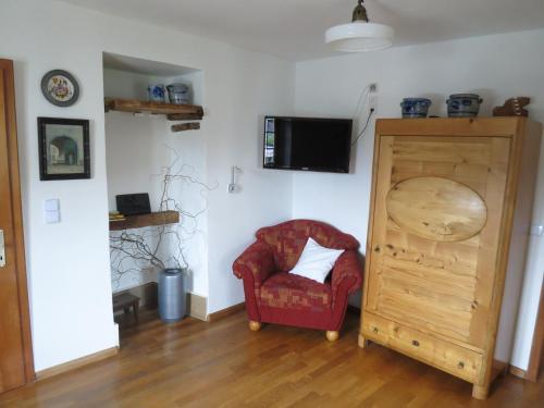 Ein Sitzbereich in der Unterkunft Ferienwohnungen Haus Hinneres