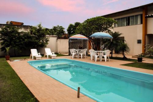 The swimming pool at or near Apartamento do Luiz