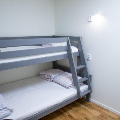A bunk bed or bunk beds in a room at 3 Star Hostel