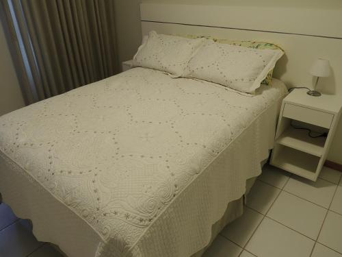 A bed or beds in a room at Apartamento 2 quartos Living Park Sul