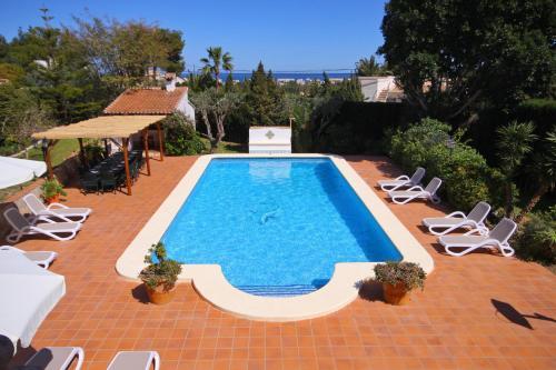 The swimming pool at or near Villa Pinosol