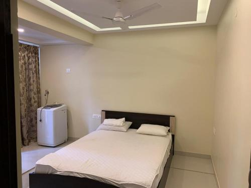 A bed or beds in a room at Monarch Palms Candolim