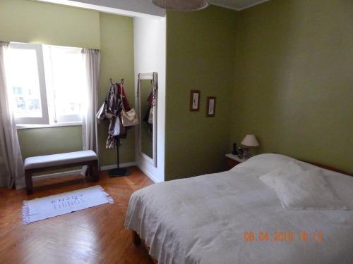A bed or beds in a room at Luminoso y amplio apartamento de 90 m² en Punta Carretas