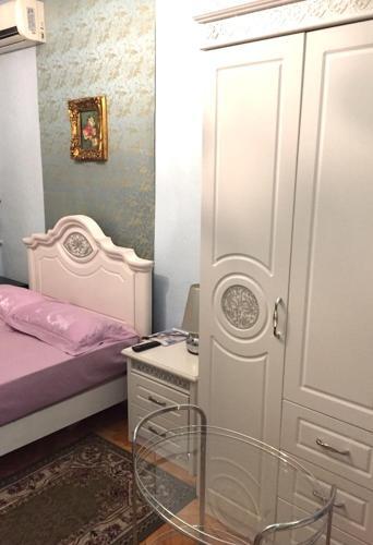 Кровать или кровати в номере Guest House Moscow Style