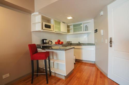 Una cocina o kitchenette en ARC Callao Studios & Suites