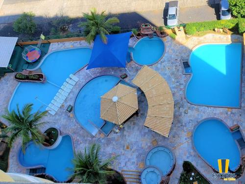 A view of the pool at Esteves em Caldas or nearby