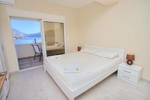 Postel nebo postele na pokoji v ubytování Sea Star Luxury Apartment