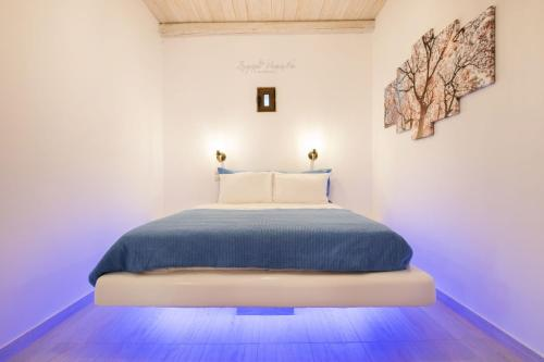 A bed or beds in a room at Anemolia Villa
