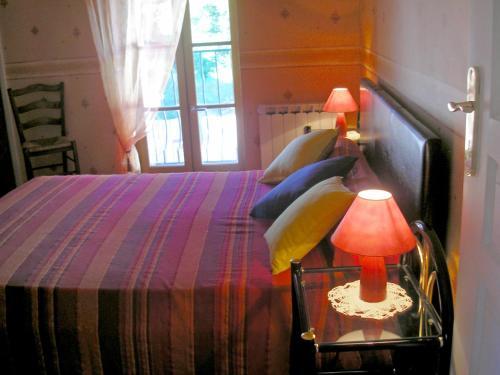 Un ou plusieurs lits dans un hébergement de l'établissement Holiday Home Luzillé