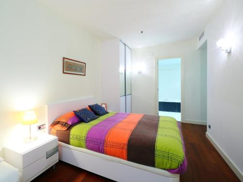 A bed or beds in a room at Apartment Diagonal Mar