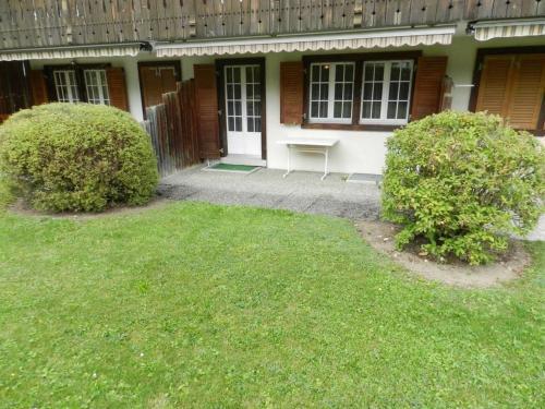 Ein Garten an der Unterkunft Apartment Résidence Sonnegg (Vuilleumier)