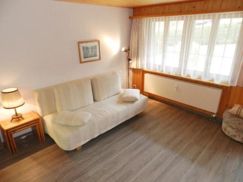 Ein Sitzbereich in der Unterkunft Apartment Résidence Sonnegg (Vuilleumier)