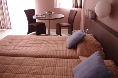 A bed or beds in a room at Résidence Les Baladines