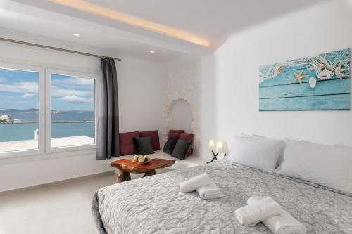 A bed or beds in a room at Magic View Suites Mykonos