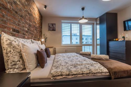 Posteľ alebo postele v izbe v ubytovaní Amos Apartment