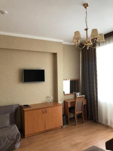 A television and/or entertainment center at Liberty Fly Hotel