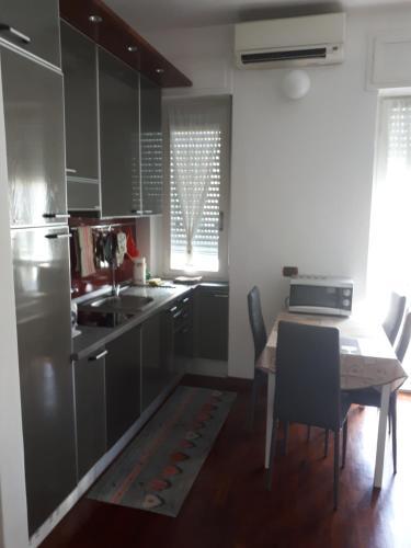 A kitchen or kitchenette at Valassina milano apartment