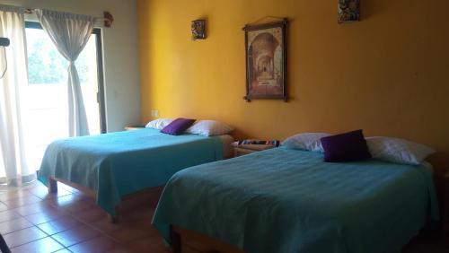 A bed or beds in a room at Las Terrazas del Cortés