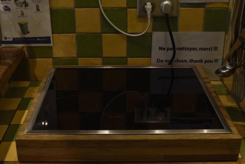 Een keuken of kitchenette bij La Coloniale