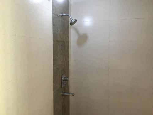 A bathroom at HomeNow - Full Kadambari - Botanical Garden Metro