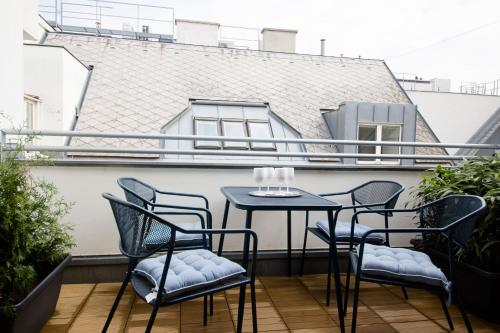 A balcony or terrace at The Flats Apartments - Opera