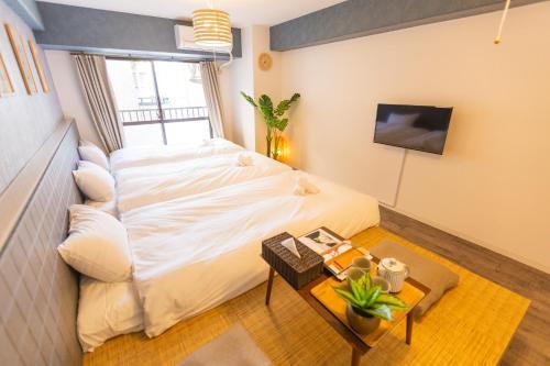 Ліжко або ліжка в номері Chuan Flat Nagahoribashi