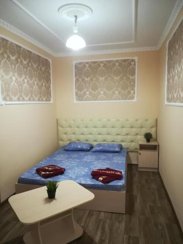Кровать или кровати в номере ГОСТЕВОЙ ДОМ НА ПРОТАПОВА