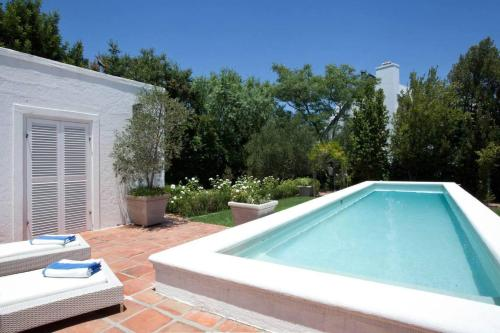 The swimming pool at or near La Maison Blanche