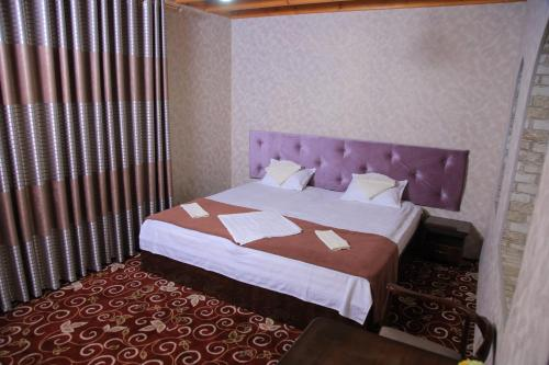 A bed or beds in a room at Adras House Hotel