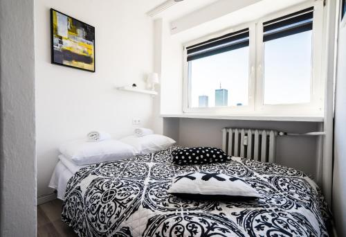 A bed or beds in a room at Elegant Apartment Panoramic