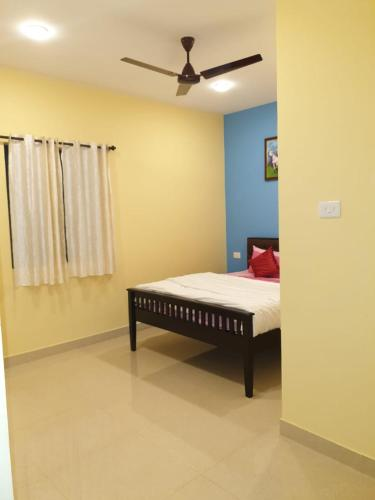 A bed or beds in a room at Alex guest house