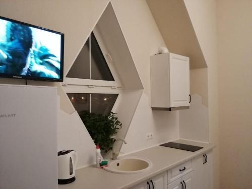 A television and/or entertainment centre at Apartment in Glazynino